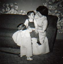 Uncle Bruce sitting in Grandma's lap, and Dad  - 1956 - good days.
