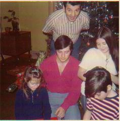 Me in the red shirt, age 13, Dad bending down to fit in picture aunt Peggy on Dad's right aunt Linda to his left with brother Dave in front. - 1968 - Ava on his left with uncle Tom kneeling in front.