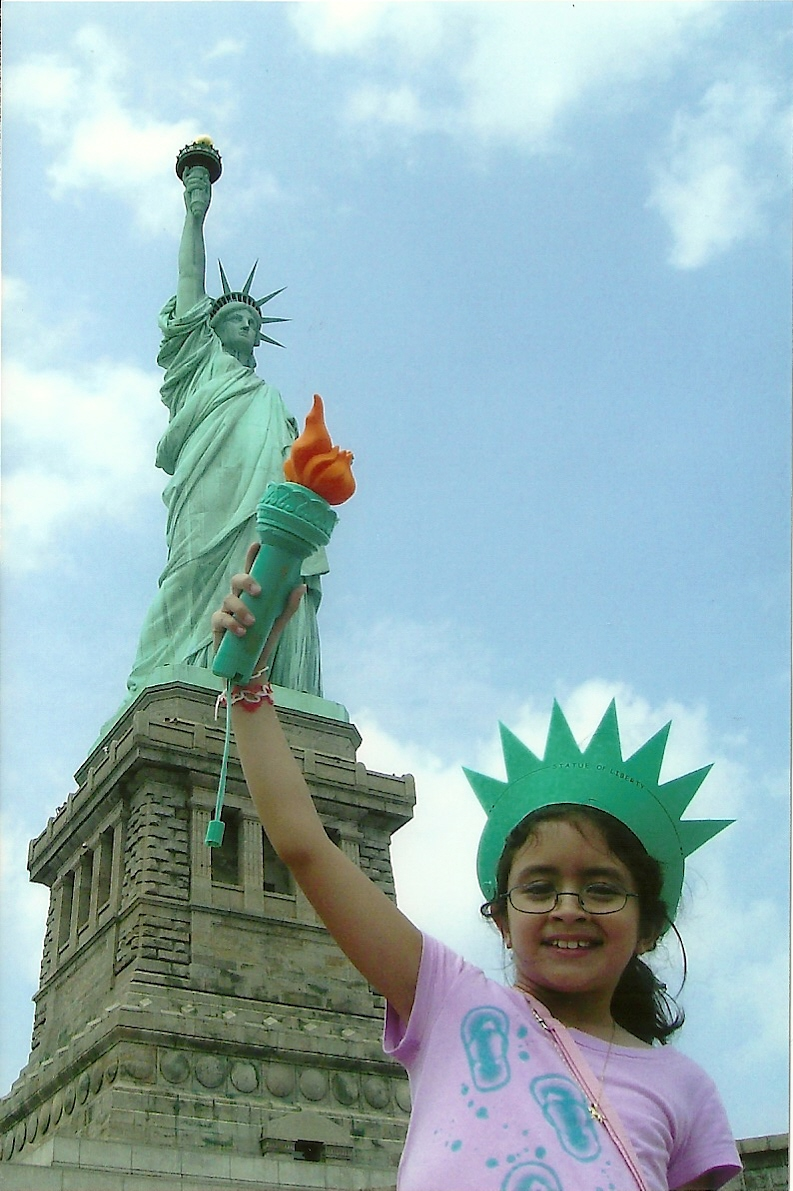 Stephanie at the  Statue of Liberty