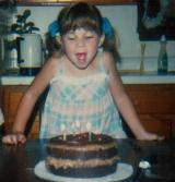 Anna blowing out candles... 1980