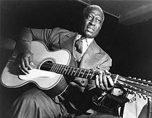 """""""Lead Belly"""" and his 12 string."""